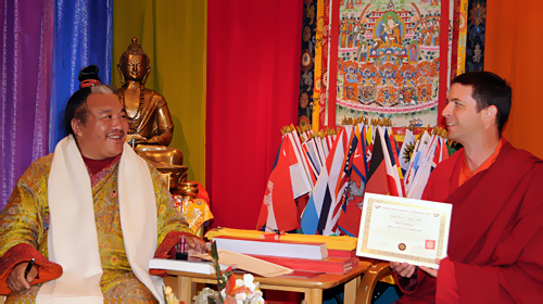 Dzogchen Khenpo Choga Rinpoche presenting Orgyen Zangpo with a certificate authorizing him to teach Buddhadharma in the tradition of the Dzogchen Lineage.